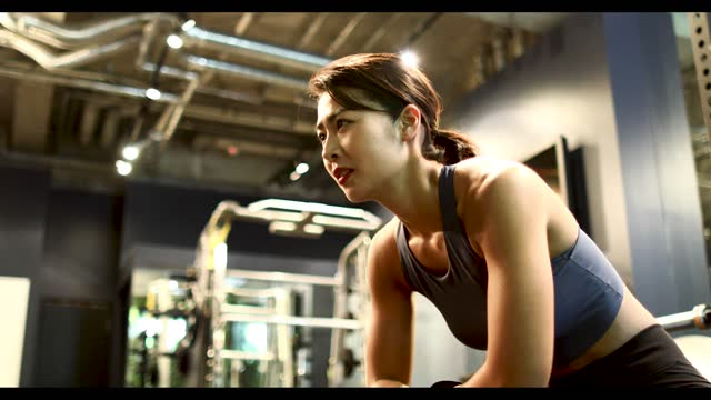 a woman shows a tired expression after finishing her training - durability stock videos & royalty-free footage