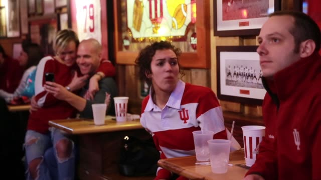 vídeos de stock, filmes e b-roll de a woman shows her frustration as the indiana university hoosiers are playing basketball against against university of kentucky during the ncaa... - bloomington indiana