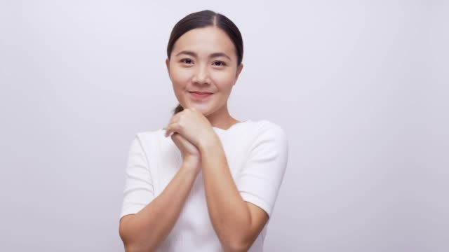 Woman shy look at camera on isolated white background 4k