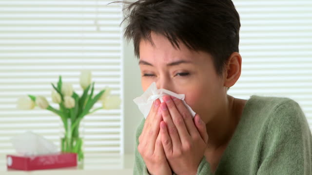 woman sick with flu sneezing - infectious disease stock videos & royalty-free footage