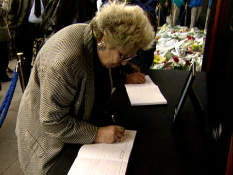 woman signs a book of condolence at harrods for diana princess of wales and dodi fayed. 01 september 1997. - mourner stock videos & royalty-free footage