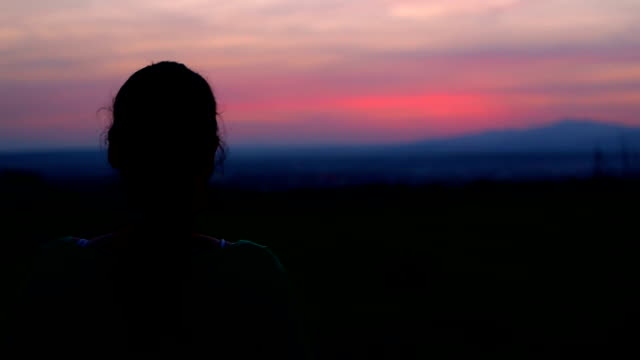 woman sihouette at sunset - saturated color stock videos and b-roll footage