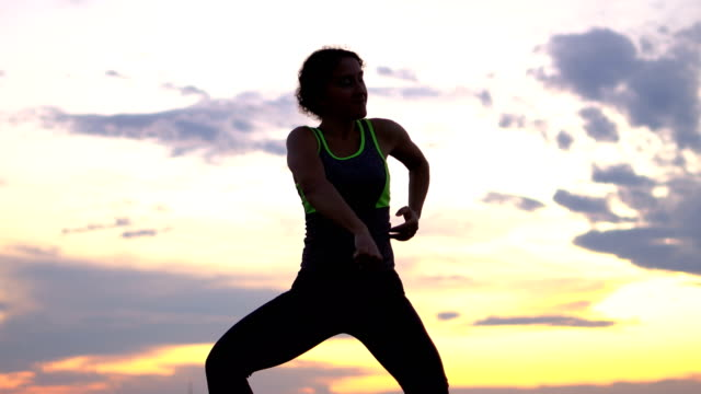 woman silhouette dancing at sunset - silhouette stock videos & royalty-free footage