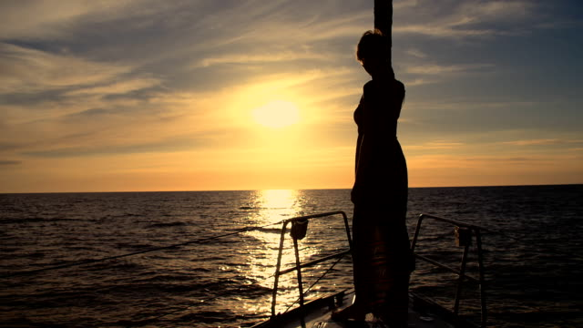 slow mo woman silhouette standing on the bowsprit - standing stock videos & royalty-free footage