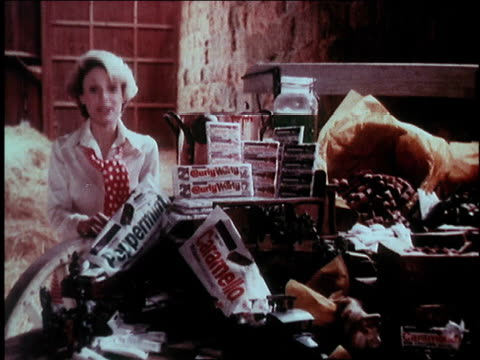 vídeos de stock e filmes b-roll de 1974 montage woman singing about cadbury chocolate /united states - 1974