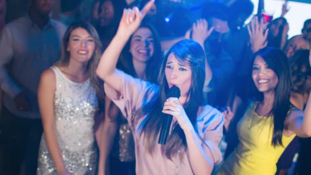 Woman singing at the nightclub