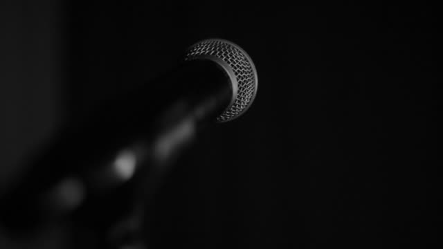 a woman singing into a microphone, tone rehearsal before a performance - microphone stock videos & royalty-free footage