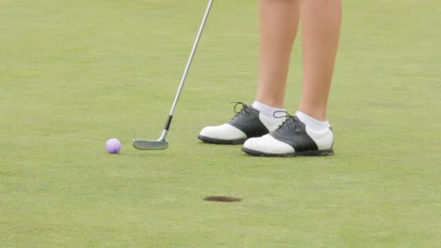 woman sinking short put - golf shoe stock videos & royalty-free footage