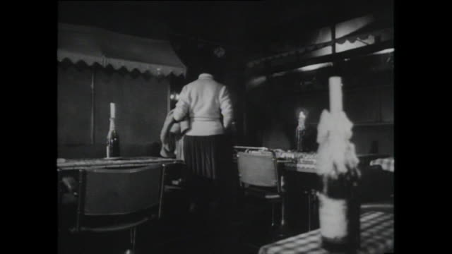 woman sits in shadowy corner of empty restaurant; 1959 - skirt stock videos & royalty-free footage