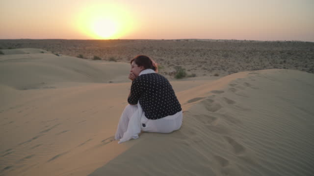 woman sits on sand dune - rajasthan stock videos and b-roll footage