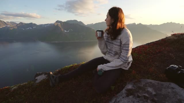 woman sitting and drinking tea in senja mountains - drinking stock videos & royalty-free footage