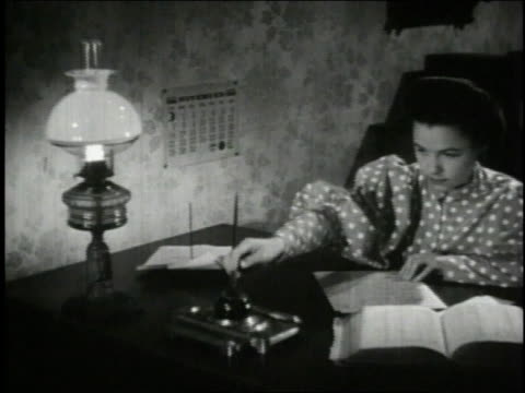 1940 ms woman sitting at desk writing letter with pen and ink / united states - correspondence stock videos & royalty-free footage