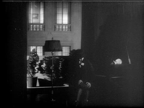 ms, b&w, woman sitting at grand piano, switching lights on and off, 1920's  - lichttyp stock-videos und b-roll-filmmaterial
