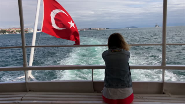 woman sitting behind the boat with turkish flag - turkish ethnicity stock videos & royalty-free footage