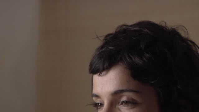 vídeos y material grabado en eventos de stock de cu td woman sitting cross-legged on floor and meditating/ rome, italy - cross legged