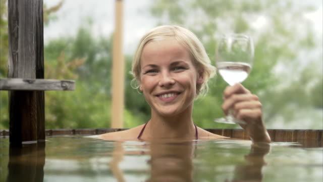 a woman sitting in a bath tub sweden. - health farm stock videos & royalty-free footage