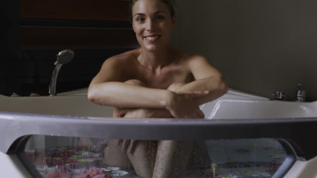 woman sitting in a bathtub