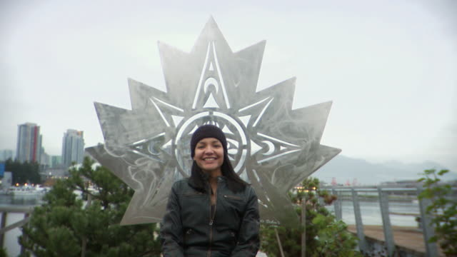 MS Woman sitting in front of sculpture / Vancouver, British Columbia, Canada