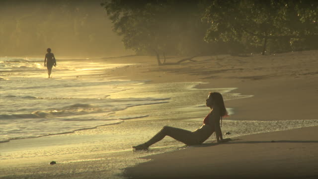 woman sitting in the surf - see other clips from this shoot 1157 stock videos & royalty-free footage