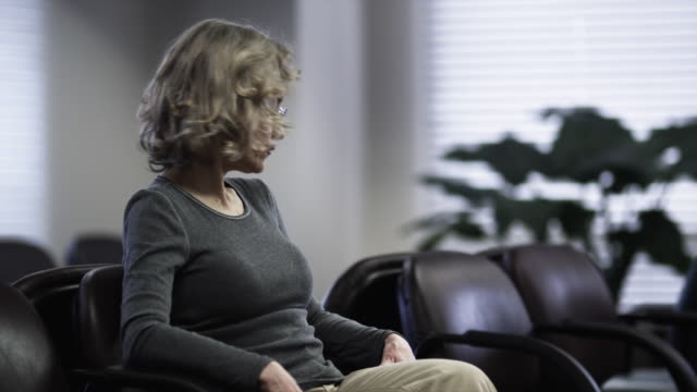 MS Woman sitting in waiting room / Payson, Utah, USA