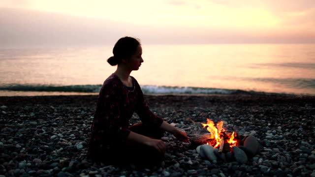woman sitting near the fireplace - caucasus stock videos and b-roll footage
