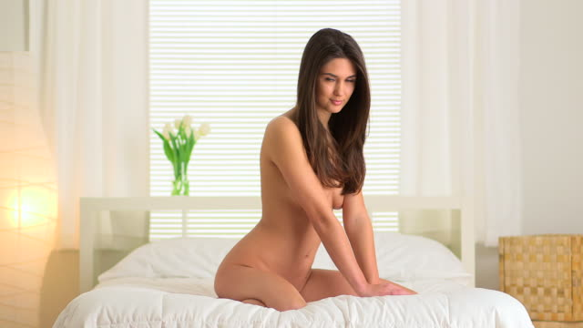 woman sitting on bed - naked stock videos & royalty-free footage