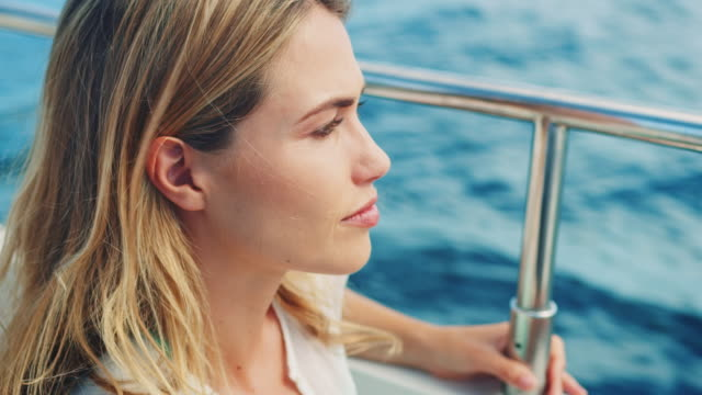 woman sitting on boat - yacht stock videos & royalty-free footage