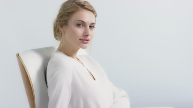 woman sitting on chair against white background - grooming product stock videos & royalty-free footage