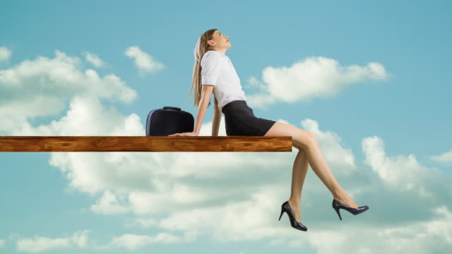 woman sitting on edge of plank relaxing - matte board stock videos & royalty-free footage