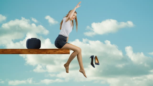 woman sitting on edge of plank relaxing - dress shoe stock videos and b-roll footage