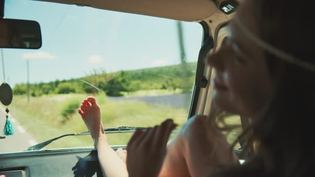 woman sitting with feet up while traveling in van - feet up stock videos & royalty-free footage