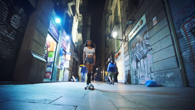 woman skateboarding on street at night - barcelona spain stock videos & royalty-free footage
