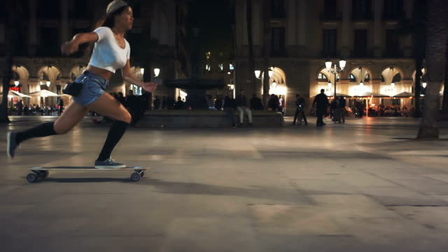 woman skateboarding on street at night - skating stock videos & royalty-free footage