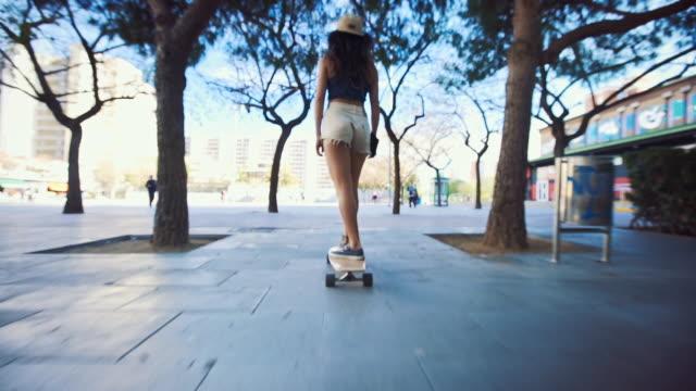 woman skateboarding on street - longboarding stock videos & royalty-free footage