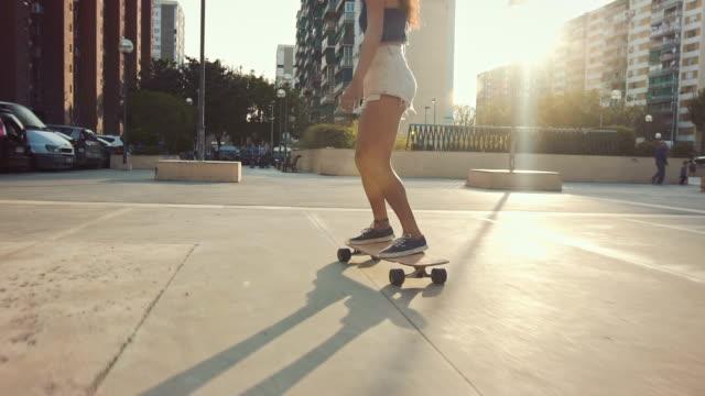 Woman skateboarding on street