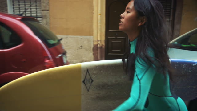 woman skateboarding on street - promenade stock videos & royalty-free footage