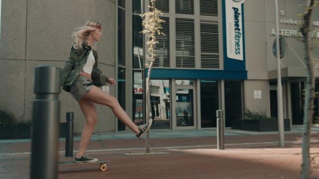 woman skating in urban setting - longboarding stock videos & royalty-free footage