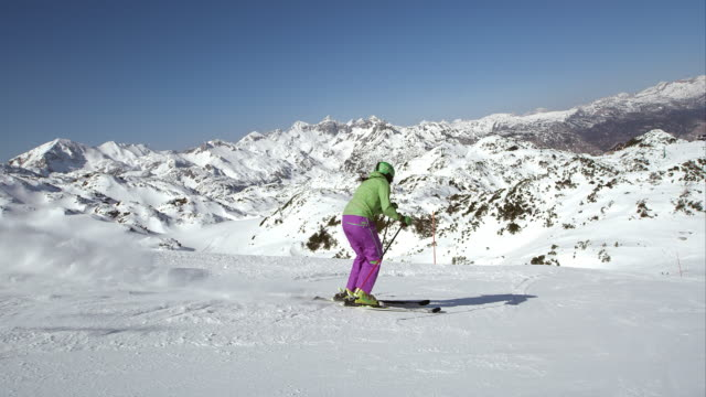slo mo ts woman skier skiing down the ski track - ski slope stock videos & royalty-free footage