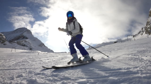 woman skiing at glacier in the alps - ski holiday stock videos & royalty-free footage
