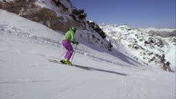 TS Woman skiing down ski slope