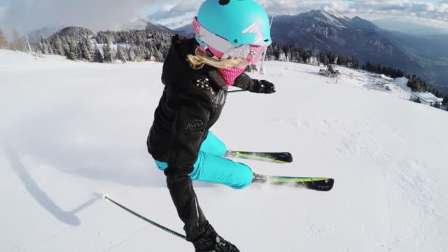 pov woman skiing down ski slope - slalom skiing stock videos & royalty-free footage
