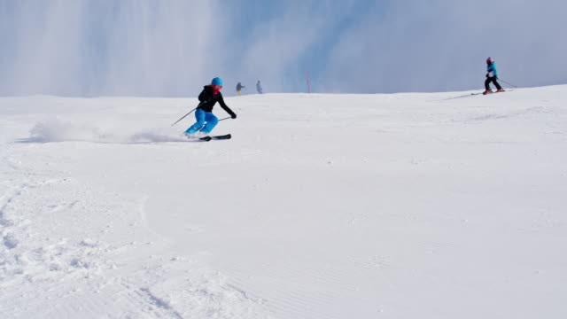 SLO MO Woman skiing down ski slope