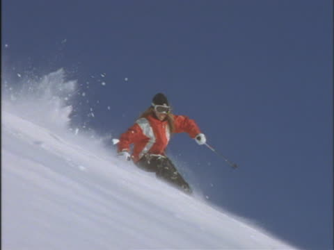 woman skiing downhill - skiwear stock videos & royalty-free footage