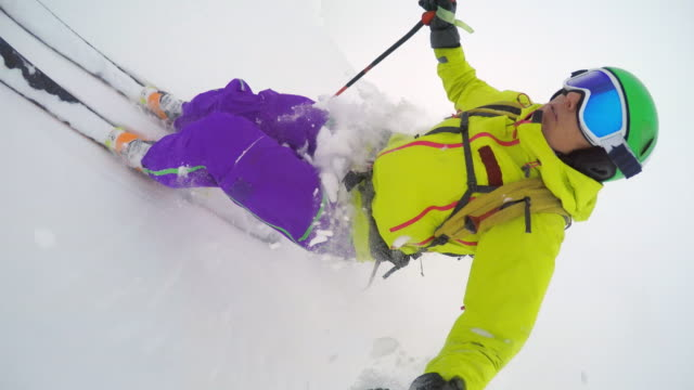 POV Woman skiing in powder snow