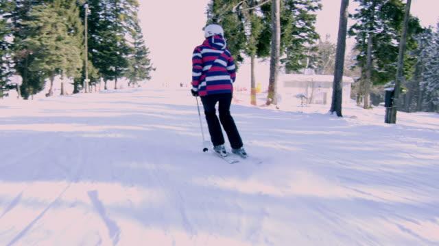 4k woman skiing on snowy ski slope, slow motion - alpine skiing stock videos & royalty-free footage