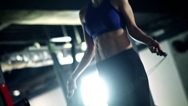 woman skipping rope in the gym - sports bra stock videos & royalty-free footage