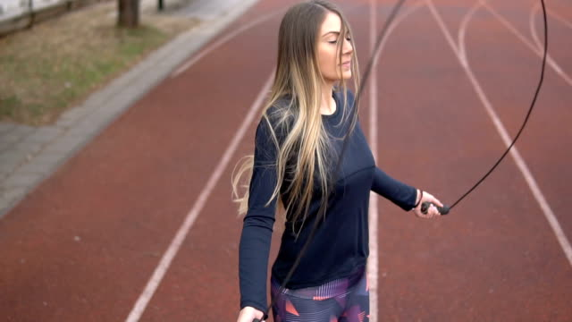 Woman skipping rope outdoors