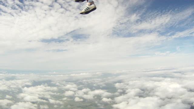 Woman sky diver performs acrobatic mid-air stunts