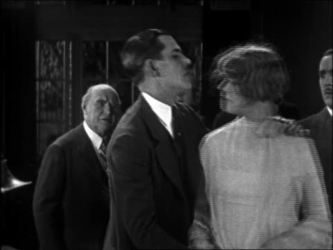 B/W 1926 woman slapping man (Charley Chase) with arms around her / feature