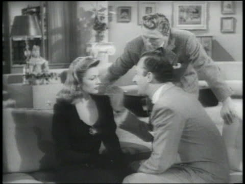 B/W 1948 woman slaps man touching her face (Keenan Wynn) as other man (Kirk Douglas) watches